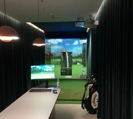 WeWork golf simulator