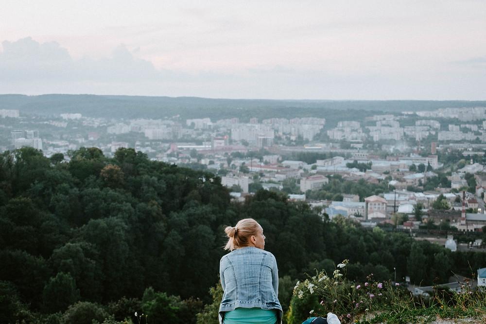 A traveler contemplating after reaching her destination.