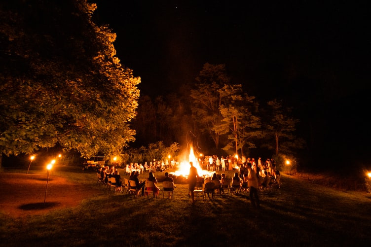 People gathered around a fire in a circle.