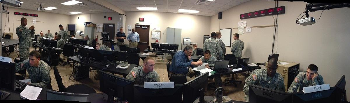 Armed Forces (Military) Personnel working inside of the Battle Command Training Center