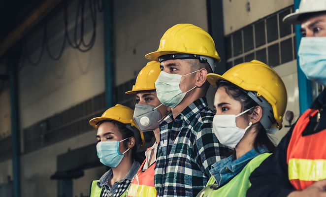 Construction workers wearing masks