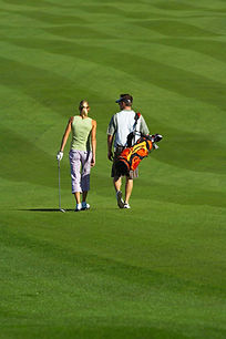 Golfing Couple at Mackinaw Club 18 hole golf course