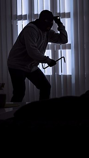 Burglar invading an unsecured home. All Home Central provides Security Systems and Monitorin