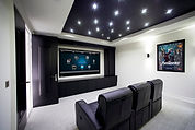 A living roo with in wall speakers, projection TV large screen TV, LED OLED television, optomized for hom theater viewing. All Home Central install , designs and consults on allhouse entertainment systems.