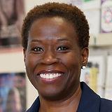 Venida C. Rodman Jenkins, a Black woman with short natural hair