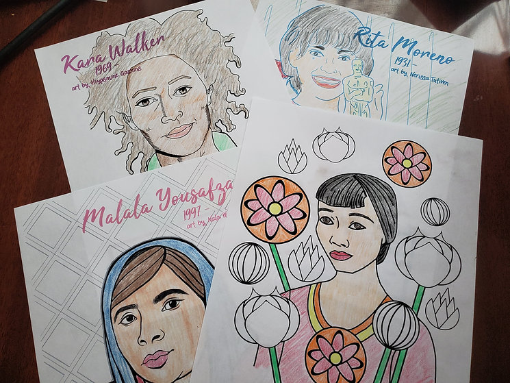 Brightly colored coloring book portraits of Malala Yousafzai and Anna Mae Wong lay on a table.
