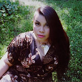 Mary J. Sansait, an Asian woman with dark hair in a half-buzzed, half-long hairstyle.