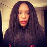 Courtney Wheeler, a Black woman with long dark hair