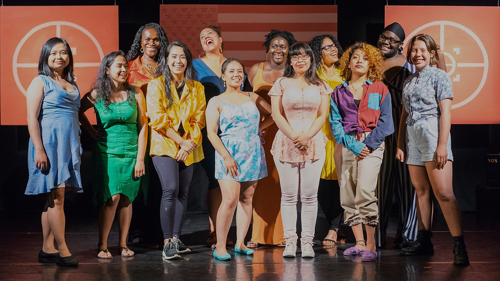 An ethnically diverse group of women, the cast of In Full Color 2018, smile and laugh.