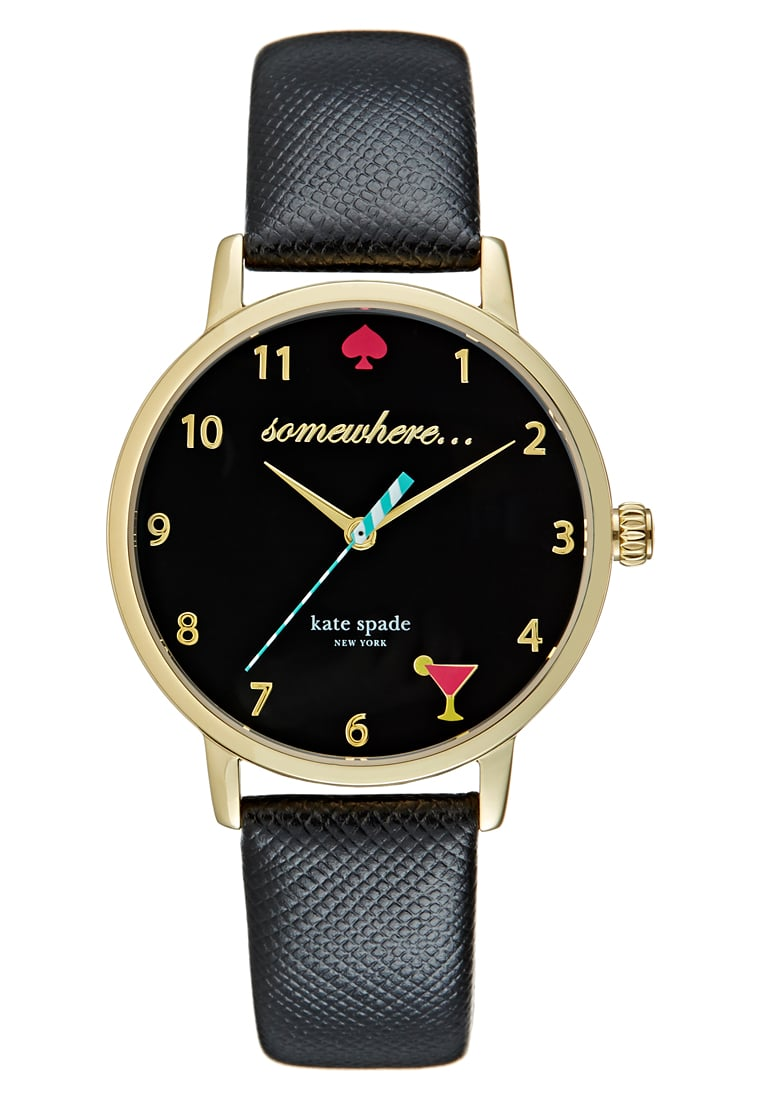 """Set your look apart from the rest and never be late for happy hour again with this chic watch from Kate Spade New York. Inspired by the big apple, the """"5 o'clock Metro"""" is one of the original styles from Kate Spade's debut collection. With a soft black leather strap, a pink spade and martini glass motif, this watch is sure to add some fun to any outfit. Remember, it's 5 o'clock somewhere ;) £161.10, de Gruchy"""
