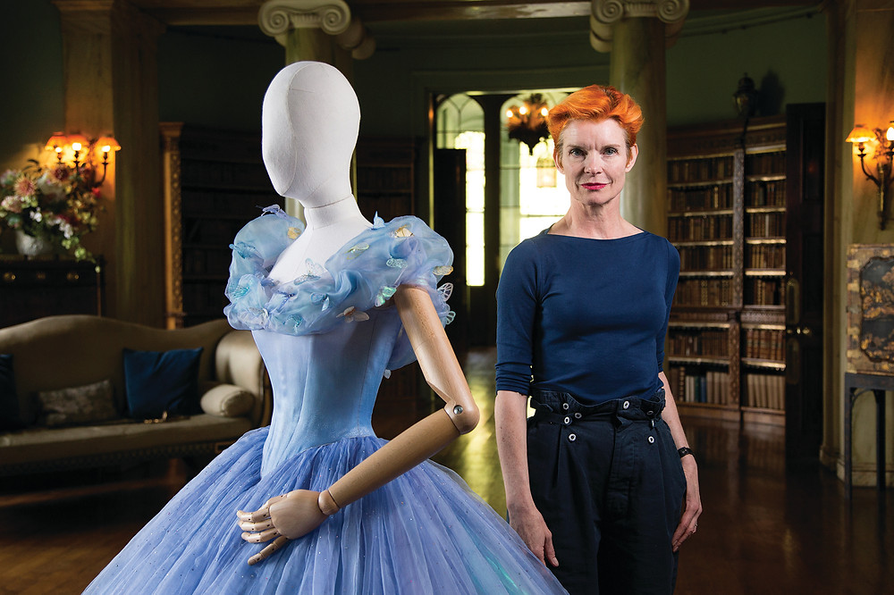 OBE Costume Designer, Sandy Powell next to the dress she created for Disney's 2015 Cinderella re-make