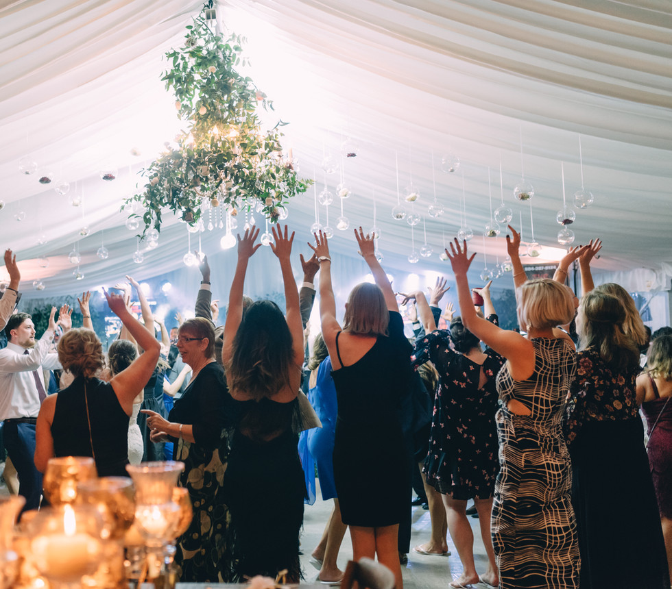 Dancing Under Bubbles, Chandeliers and Greenery