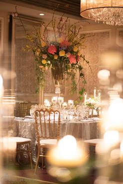 Clear Monet Stems around a tall floral arrangement