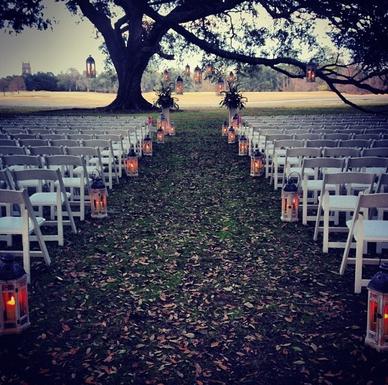 White Wooden Lanterns Down the Aisle
