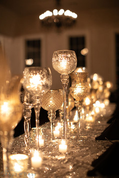 Mixed Silver stemmed candles and votives