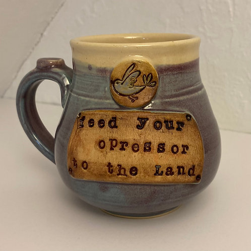 Feed your oppressor to the land mug