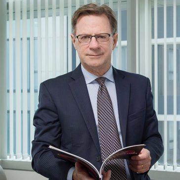 Dr Christopher TREMEWAN