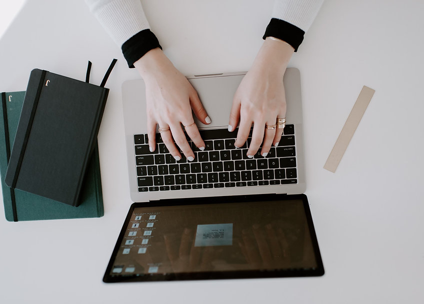female-business-owner-working-on-a-lapto