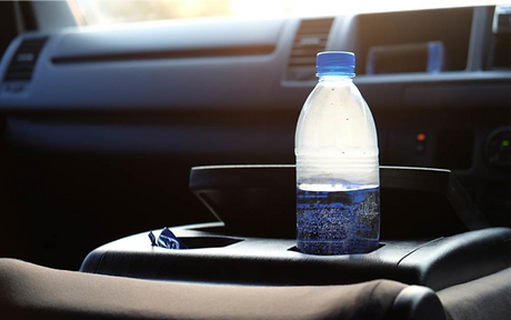 Plastic Bottle in Car.png