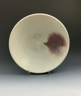 Large serving bowl in white with copper red splash