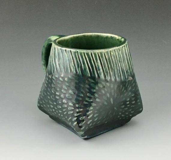 Folded handbuilt mug in celadon green