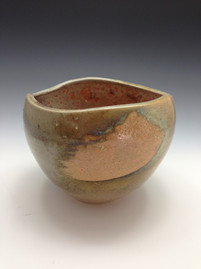 Organic shaped wheelthrown and altered vase by Kate Chenok