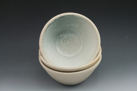 Cereal bowl with white and blue glaze inside and raw clay outside