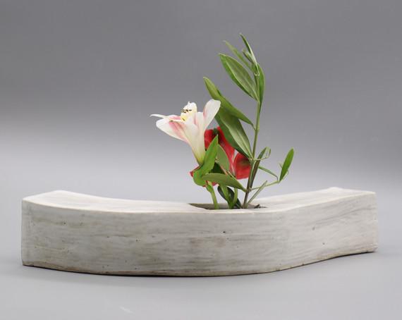 Extruded curved ikebana vase by Glazed Over Ceramics Orinda