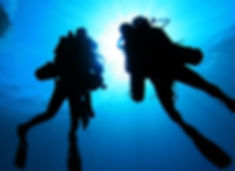 Silhouette of Scuba Divers