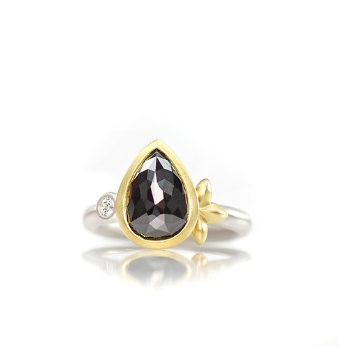 platinum  black diamond ring with single white diamond and triple leaf in 18kt