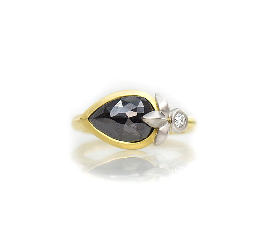 18kt black diamond platinum triple leaf ring with single white diamond