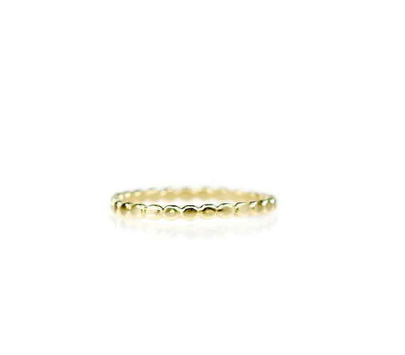 tiny pebble eternity band in 18kt yellow