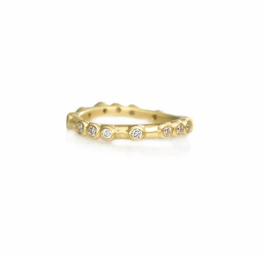 narrow random sparkles diamond eternity band in 18kt yellow gold