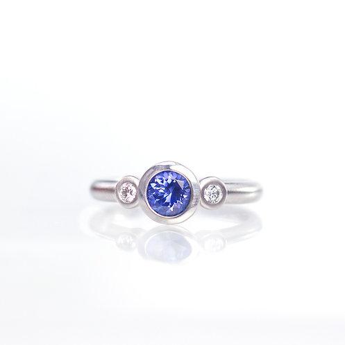 blue sapphire and diamond three stone ring in palladium
