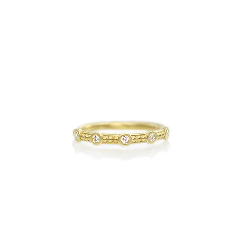 18kt beaded band with five diamonds