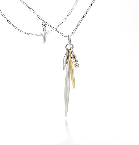 platinum and 18kt beach grass triple diamond pendant on a platinum chain
