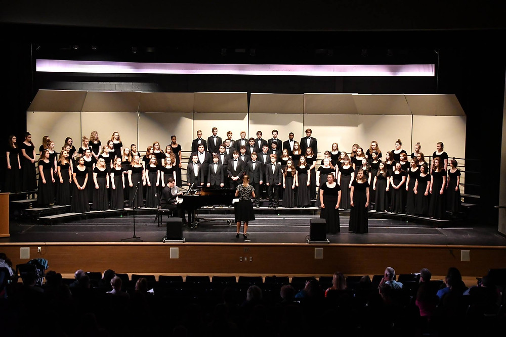 """Combined choral groups perform """"We Rise Again,"""" at the May 22, 2018 Choral Night"""