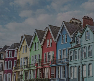 A row of brightly coloured houses.