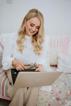 Bridal hairstylist on laptop