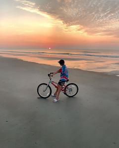 boy on bike during sunrise