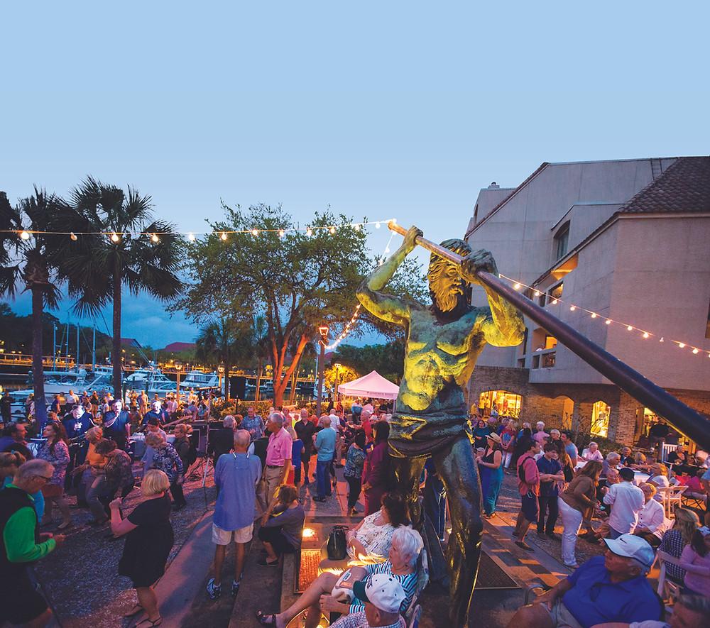 crowd enjoys music under shelter cove neptune statue