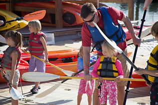 father and daughter holding oar