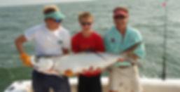 Three Men Holding One Fish