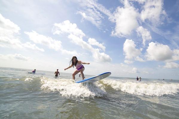 Little girl surfing on Hilton Head Island