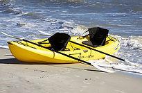 yellow double kayak on beach
