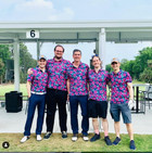 Male Golfers in matching polos at Toptracer Golf Range