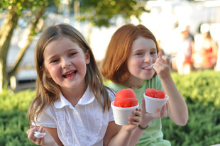 Girls eating snow cones at HarbourFest