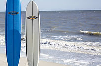 two surf boards in sand