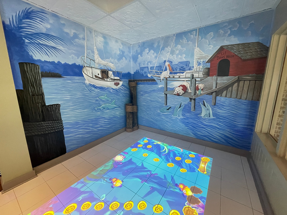 mural on wall of Top Dawg's kids section with interactive floor