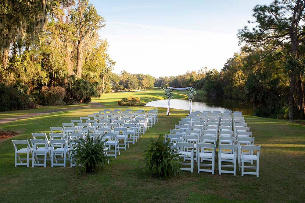 ceremony chair setup with arch overlooking water